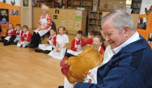 88-year-old Ossie Cresswell with Peggy the Bluebell hen & some young henpals from Newburn Manor school